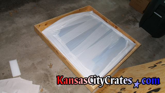 Stained glass window packed in wood crate for shipping.