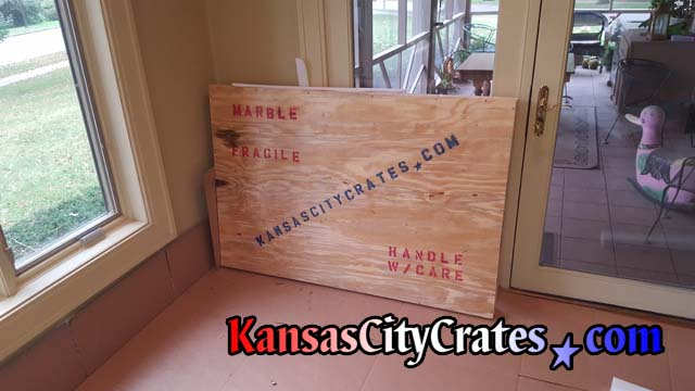 Crate is placed on cardboard ready for loading