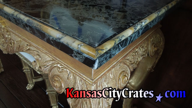 Sienna marble top with Carrara marble inlaid trim.