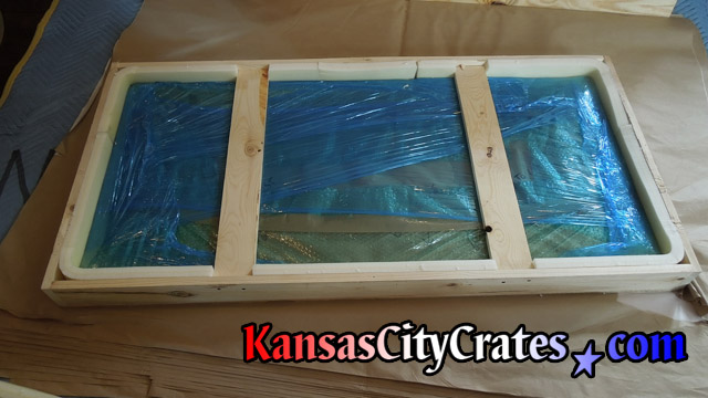 Marble top fully packed in foam lined crate for shipping.