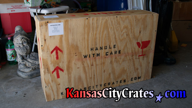 Wooden crate labeled for transport.