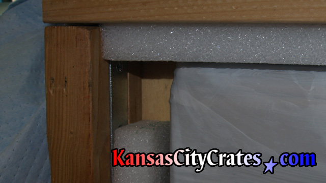 Foam edges of granite top crate protect corners during handling.