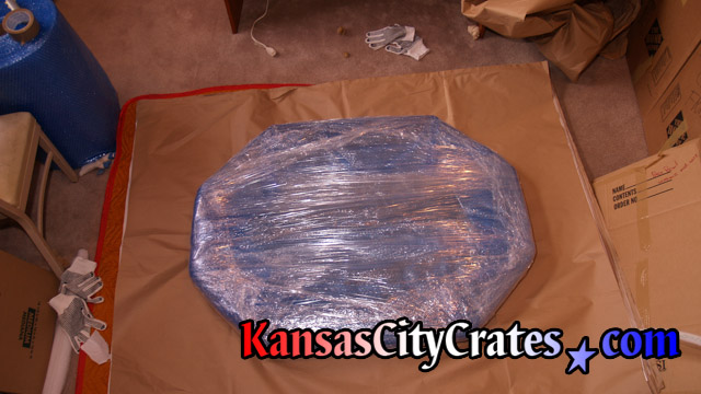 Mirror wrapped in paper, bubble and stretch wrap before placing into wood vault like crate.