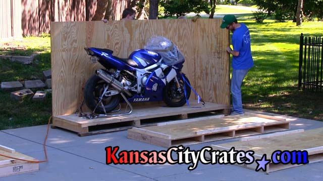 Side panel and front end panel of crate for  motorcycle installed