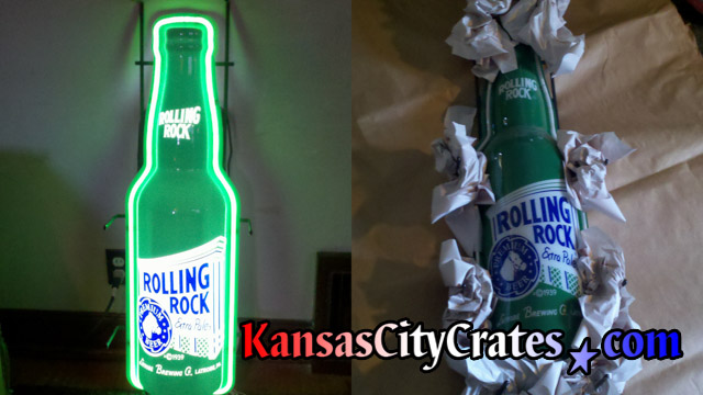 Two views of Rolling Rock neon sign being crated for shipping.