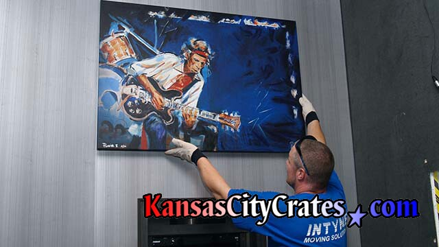 Oil painting by Ronnie Wood that captures Keith Richards playing guitar.