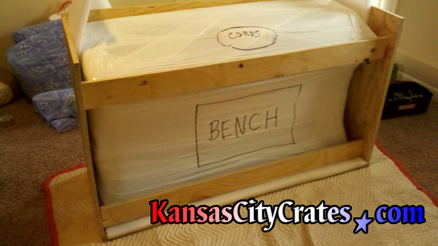Once stretch wrapped, the piano is marked to help handlers removing from crate to prevent damage.