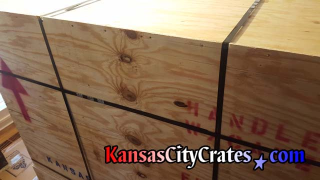 International solid wall crate is reinforced with steel banding