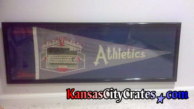 Original Kansas City Athletics Pennant in glass case before crating.