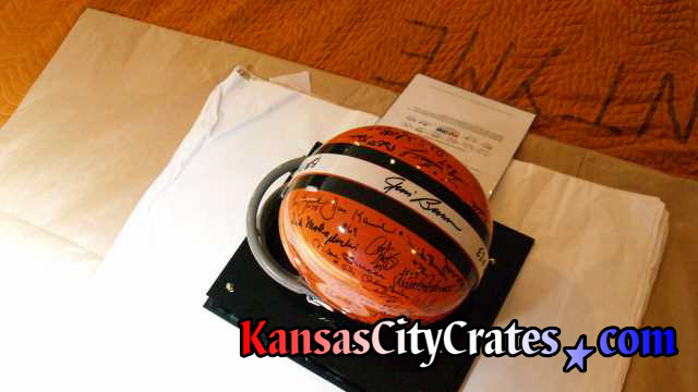 Football helemt on acid free paper with Certificate of Authenticity being wrapped for packing into wood crate.