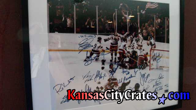 The Miracle on Ice framed lithograph signed by hockey player being crated for transport.