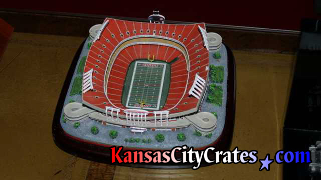 Packing for crate small scale model of Arrowhead Stadium in Kansas City.