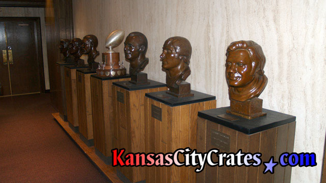 6 football bust sculptures for packing into wood crates.