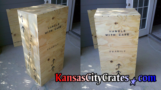Two views of export crate with replica marble statue of Christ The Redeemer
