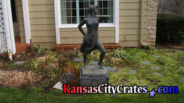 Bronze statue of female dancer on marble base in yard at home Mission Hills KS  66208
