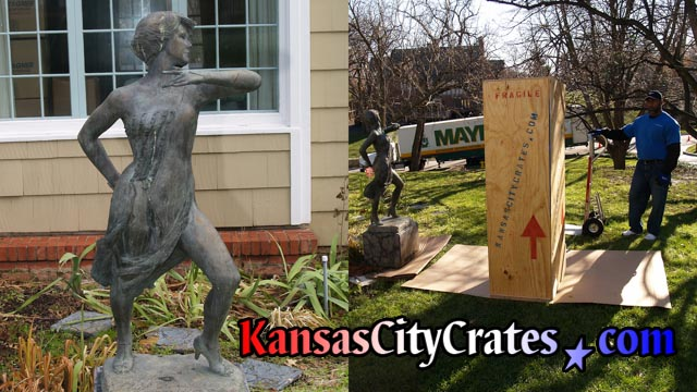 Solid wall export crate in yard with bronze statue of dancer staged on carboard for packing.