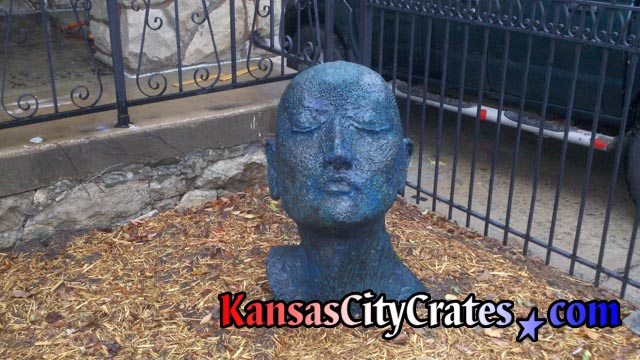 Statue near Kansas City Art Institute named A Fit of Sullenness to be packed in export crate for transport.