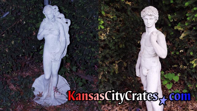 Concrete statues of Venus & David in garden by pool before crating.