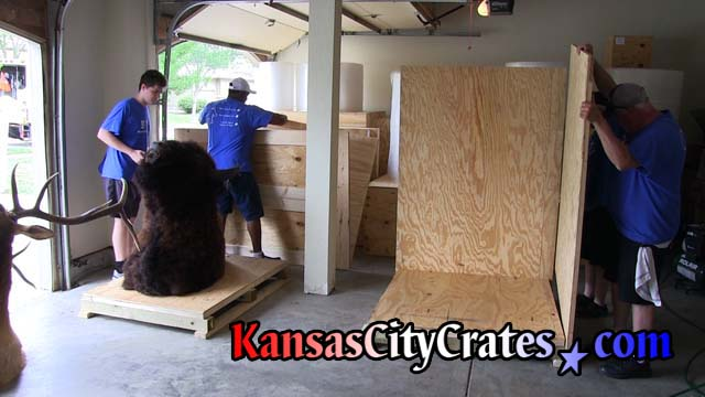 Solid wall crates in garage of home to pack taxidermy for shipping to Rocklin CA 95765