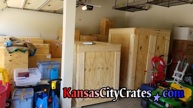 Both large crates are completed and in place with other crates