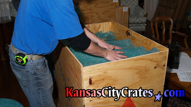 Plywood sheathed crate with bubble wrap for void fill at home in Kingsville MO  64061