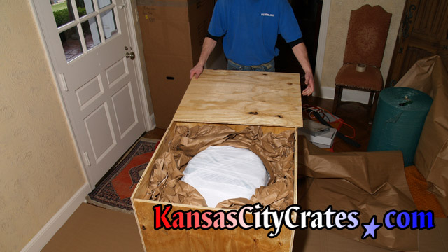 Void fill of wood box crate with heavy paper pads at home in Kansas City MO  64167