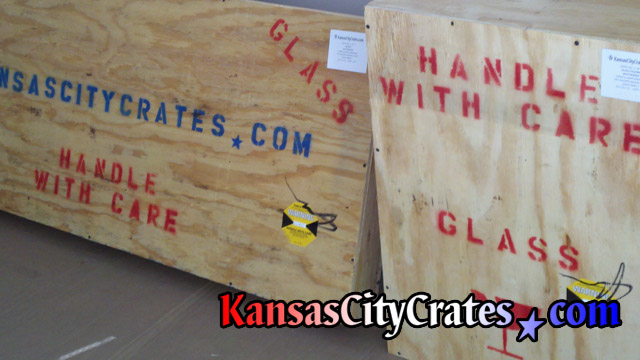 Wooden crates marked for shipment containing glass tops and a glass statue at home in Overland Park KS  66204