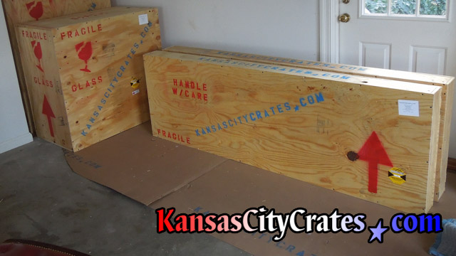Four ISPM-15 wood boxes with Shockwatch impact indicators marked for shipment at home in Kansas City MO  64138