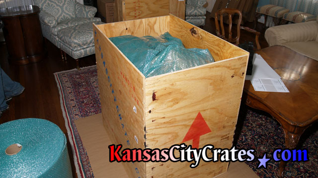 Solid wall plywood sheathed crate for carefully packed hand made dollhouse at home in Lansing KS  66043