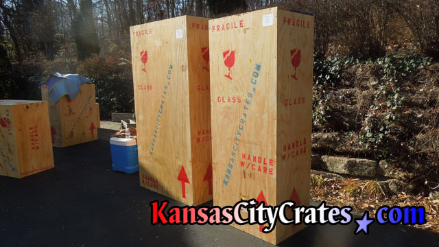 Large wood crates marked for transport on driveway at home in Greenwood MO  64034
