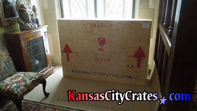 Large wood crate marked for shippment with hallway mirror packed inside at home in Lenexa KS  66220