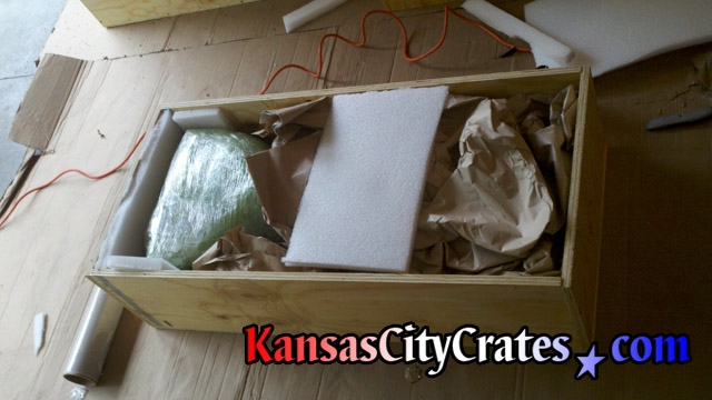 Open view of marble statue packed inside solid wall all wood crate with void fill to eleimiante shifting during transport at home in Olathe KS  66062
