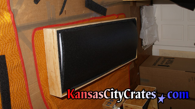 Oil painting protected with foam lining on all four sides in wood crate at home in Grandview MO  64030