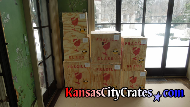 7 plywood box crates marked for transport at home in Harrisonville MO  64701