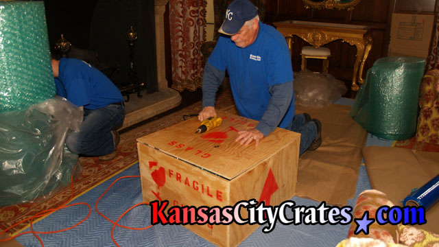 Packing wood crates at home in Mission KS  66202