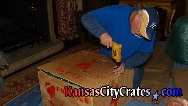 Fragile item packed in bubble wrap inside all wood solid wall crate at home in Knob Noster MO  65336