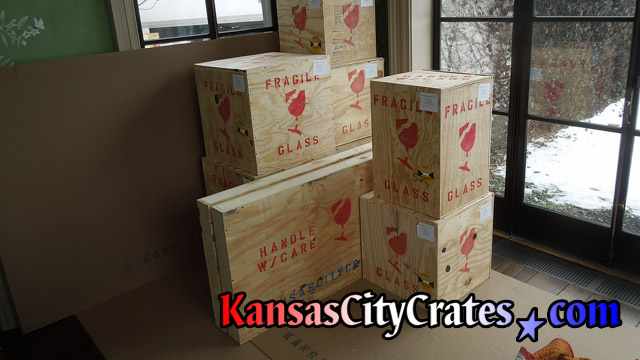 Plywood sheathed crates sitting with property protections at home in Kearney MO  64060