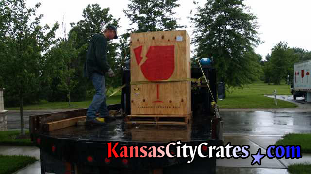 Wood vault like crate on shipping skid loaded onto back of truck at home in Leawood KS  66211