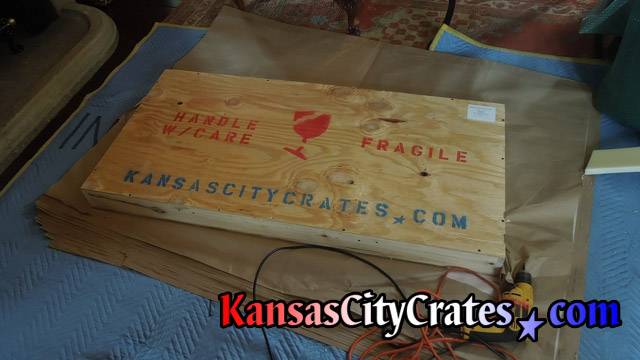 All wood crate marked for shipment at home in Lathrop MO  64465