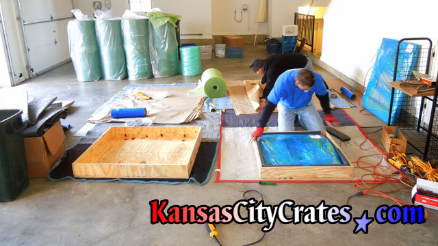 Job site photo of craters packing wooden crates at home in Odessa MO  64076