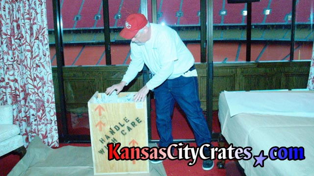 Packing wood crate in suite at Arrowhead Stadium in Kansas City during stadium rennovations.