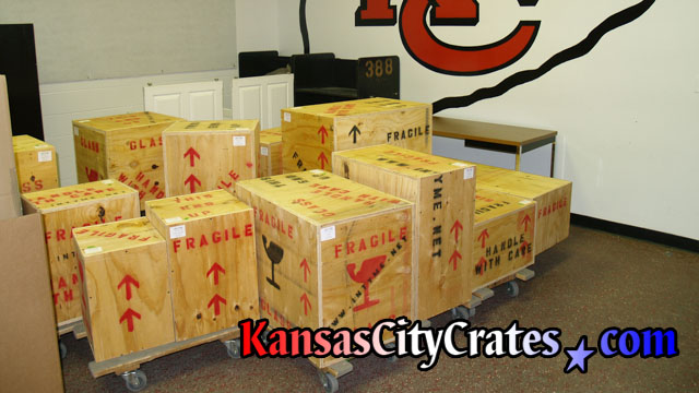 23 indestructible wood box crates sitting on carts in tunnel at Arrowhead Stadium in Kansas City MO