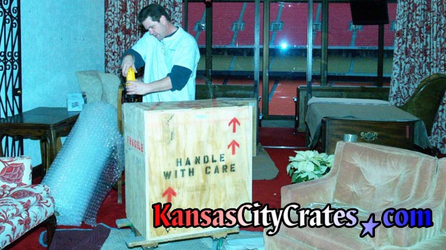 Artwork packed in indestructible wood box crate at Arrowhead Stadium Kansas City MO
