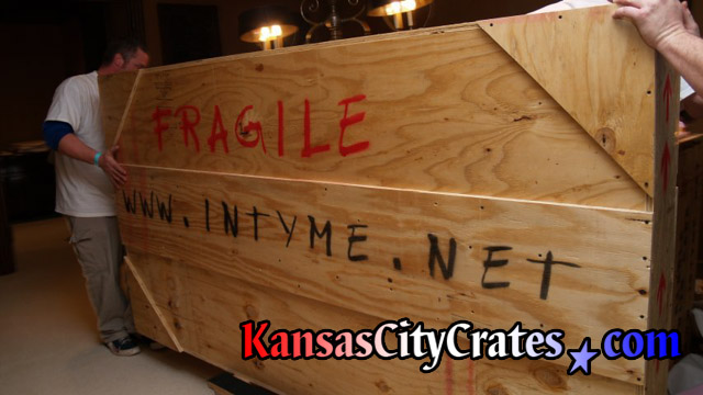 Moving wooden crate on cart at home in Kansas City MO