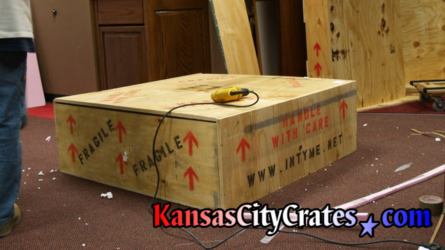 Game play recreation packed into wood crate at visitors are of NFL team office in Kansas CIty.