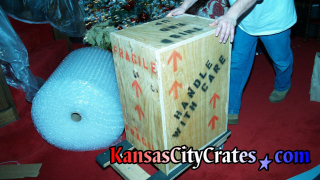 Packing indestructible wood box during Christmas at suite in Arrowhead Stadium