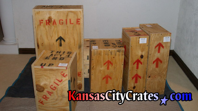 Private art collector crates on flooring protection.