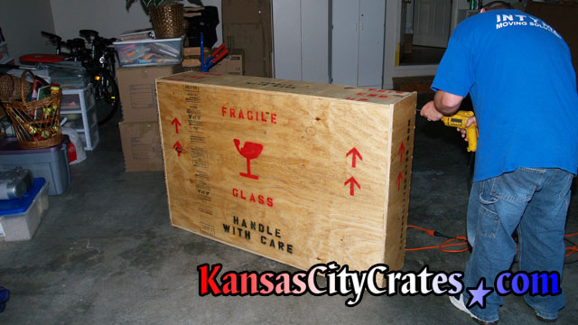 Crater closing crate before adding shipping labels.