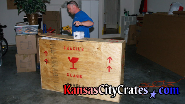 Attaching lid to fully packed indestructible wood box crate at home in Lone Jack MO  64070