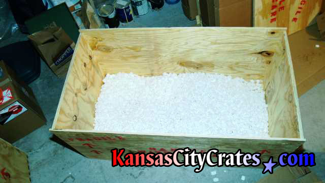 bottom of export crate filled with foam peanuts